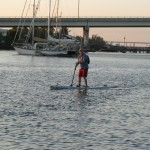 paddleboarder at dawn